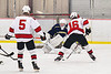 Baldwinsville Bees Luke Hoskin (16) with the puck against Cazenovia Lakers goalie Cy McCrink (30) in NYSPHSAA Section III Boys Ice Hockey action at the Lysander Ice Arena in Baldwinsville, New York on Friday, January 31, 2020. Baldwinsville won 8-1.