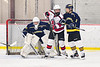 Baldwinsville Bees Matt Carner (9) battles for the position with Cazenovia Lakers George Labinski (11) and goalie Nick Korosec (31) in NYSPHSAA Section III Boys Ice Hockey action at the Lysander Ice Arena in Baldwinsville, New York on Friday, January 31, 2020. Baldwinsville won 8-1.