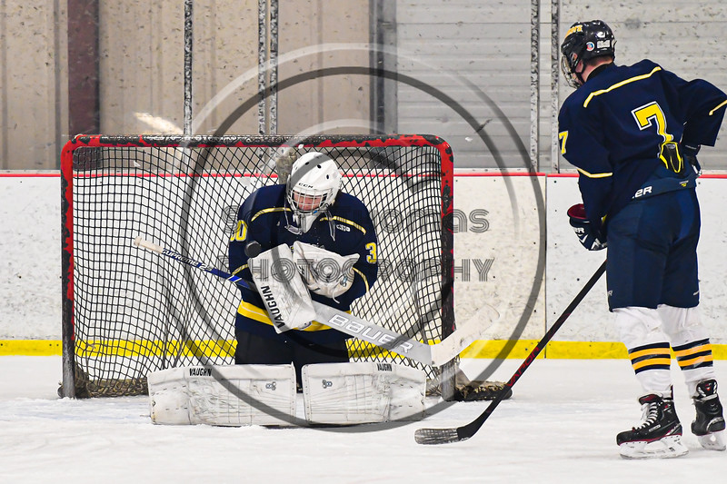 Cazenovia Lakers goalie Cy McCrink (30) makes a save against the Baldwinsville Bees in NYSPHSAA Section III Boys Ice Hockey action at the Lysander Ice Arena in Baldwinsville, New York on Friday, January 31, 2020. Baldwinsville won 8-1.