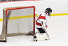 Baldwinsville Bees goalie Jon Schirmer (1) makes a pad save against the Cazenovia Lakers in NYSPHSAA Section III Boys Ice Hockey action at the Lysander Ice Arena in Baldwinsville, New York on Friday, January 31, 2020. Baldwinsville won 8-1.