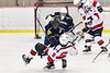 Baldwinsville Bees Cooper Foote (8) takes a hit by Cazenovia Lakers Josh Whaley (20) in NYSPHSAA Section III Boys Ice Hockey action at the Lysander Ice Arena in Baldwinsville, New York on Friday, January 31, 2020. Baldwinsville won 8-1.