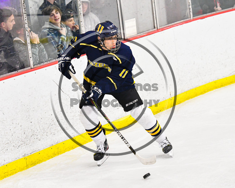 Cazenovia Lakers George Labinski (11) with the puck against the Baldwinsville Bees in NYSPHSAA Section III Boys Ice Hockey action at the Lysander Ice Arena in Baldwinsville, New York on Friday, January 31, 2020. Baldwinsville won 8-1.