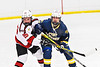 Baldwinsville Bees Brayden Penafeather-Stevenson (25) battles for position with West Genesee Wildcats Jack Mellen (23) in NYSPHSAA Section III Boys Ice Hockey action at the Lysander Ice Arena in Baldwinsville, New York on Tuesday, February 4, 2020. West Genesee won 3-1.