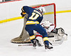 Baldwinsville Bees goalie Brad O'Neil (30) makes a save against West Genesee Wildcats Andrew Schneid (11) in NYSPHSAA Section III Boys Ice Hockey action at the Lysander Ice Arena in Baldwinsville, New York on Tuesday, February 4, 2020. West Genesee won 3-1.