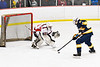 Baldwinsville Bees goalie Brad O'Neil (30) defending against West Genesee Wildcats James Schneid (15) on a Penalty Shot in NYSPHSAA Section III Boys Ice Hockey action at the Lysander Ice Arena in Baldwinsville, New York on Tuesday, February 4, 2020. West Genesee won 3-1.