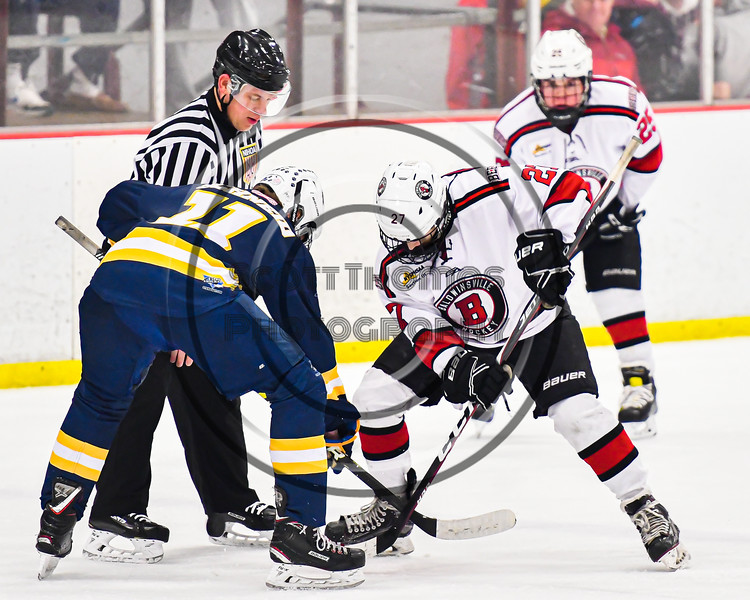 Baldwinsville Bees Tyler Derito (27) facing off against West Genesee Wildcats Andrew Schneid (11) in NYSPHSAA Section III Boys Ice Hockey action at the Lysander Ice Arena in Baldwinsville, New York on Tuesday, February 4, 2020. West Genesee won 3-1.