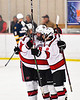 Baldwinsville Bees Connor Santay (4) and Cooper Foote (8) congratulate Luke Hoskin (16) on his goal against the West Genesee Wildcats in NYSPHSAA Section III Boys Ice Hockey action at the Lysander Ice Arena in Baldwinsville, New York on Tuesday, February 4, 2020. West Genesee won 3-1.