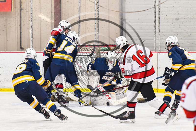 West Genesee Wildcats goalie David Myers (1) makes a save against Baldwinsville Bees Luke Hoskin (16) in NYSPHSAA Section III Boys Ice Hockey action at the Lysander Ice Arena in Baldwinsville, New York on Tuesday, February 4, 2020. West Genesee won 3-1.