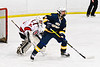 West Genesee Wildcats Jack Mellen (23) setting up in front of Baldwinsville Bees goalie Brad O'Neil (30) in NYSPHSAA Section III Boys Ice Hockey action at the Lysander Ice Arena in Baldwinsville, New York on Tuesday, February 4, 2020. West Genesee won 3-1.