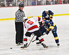 Baldwinsville Bees Alexander Pompo (5) facing off against West Genesee Wildcats Andrew Schneid (11) in NYSPHSAA Section III Boys Ice Hockey action at the Lysander Ice Arena in Baldwinsville, New York on Tuesday, February 4, 2020. West Genesee won 3-1.