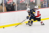 Baldwinsville Bees Brett Collier (21) checking a West Genesee Wildcats player in NYSPHSAA Section III Boys Ice Hockey action at the Lysander Ice Arena in Baldwinsville, New York on Tuesday, February 4, 2020. West Genesee won 3-1.