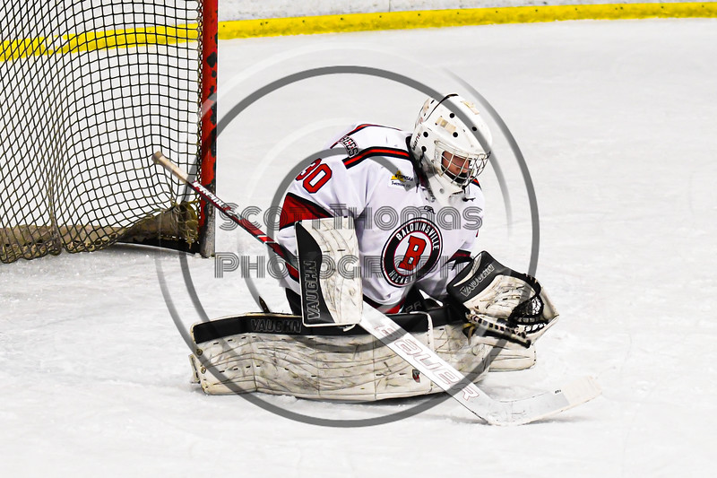 Baldwinsville Bees goalie Brad O'Neil (30) makes a save against the West Genesee Wildcats in NYSPHSAA Section III Boys Ice Hockey action at the Lysander Ice Arena in Baldwinsville, New York on Tuesday, February 4, 2020. West Genesee won 3-1.