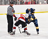 Baldwinsville Bees Brayden Penafeather-Stevenson (25) facing off against West Genesee Wildcats Andrew Schneid (11) to start a NYSPHSAA Section III Boys Ice Hockey game at the Lysander Ice Arena in Baldwinsville, New York on Tuesday, February 4, 2020. West Genesee won 3-1.