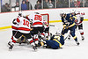 Baldwinsville Bees and West Genesee Wildcats players battling for the puck in NYSPHSAA Section III Boys Ice Hockey action at the Lysander Ice Arena in Baldwinsville, New York on Tuesday, February 4, 2020. West Genesee won 3-1.