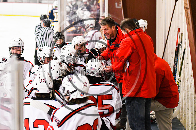 Baldwinsville Bees Assistant Coach Glenn McCaffrey during a timeout against the West Genesee Wildcats in NYSPHSAA Section III Boys Ice Hockey action at the Lysander Ice Arena in Baldwinsville, New York on Tuesday, February 4, 2020. West Genesee won 3-1.