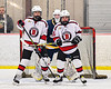 Baldwinsville Bees Matt Carner (9) and Brayden Penafeather-Stevenson (25) setting up in front of West Genesee Wildcats goalie David Myers (1) in NYSPHSAA Section III Boys Ice Hockey action at the Lysander Ice Arena in Baldwinsville, New York on Tuesday, February 4, 2020. West Genesee won 3-1.