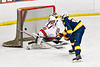 Baldwinsville Bees goalie Brad O'Neil (30) makes a save against West Genesee Wildcats James Schneid (15) on a Penalty Shot in NYSPHSAA Section III Boys Ice Hockey action at the Lysander Ice Arena in Baldwinsville, New York on Tuesday, February 4, 2020. West Genesee won 3-1.