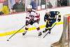 Baldwinsville Bees Connor Santay (4) skating with the puck against the West Genesee Wildcats James Schneid (15) in NYSPHSAA Section III Boys Ice Hockey action at the Lysander Ice Arena in Baldwinsville, New York on Tuesday, February 4, 2020. West Genesee won 3-1.