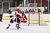 Syracuse Cougars Ryan Durand (10, not pictured) scores a goal against Baldwinsville Bees goalie Jon Schirmer (1) in NYSPHSAA Section III Boys Ice hockey action at Meachem Ice Rink in Syracuse, New York on Thursday, February 13, 2020. Syracuse won 4-0.
