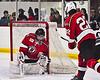 Syracuse Cougars Ryan Durand (10) hits the post behind Baldwinsville Bees goalie Jon Schirmer (1) in NYSPHSAA Section III Boys Ice hockey action at Meachem Ice Rink in Syracuse, New York on Thursday, February 13, 2020. Syracuse won 4-0.