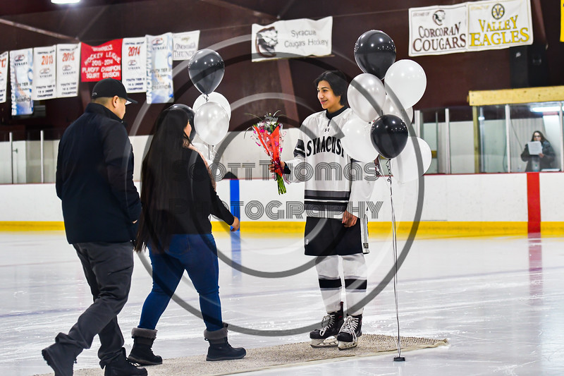 Syracuse Cougars Kaleb Benedict (5) greets his parents on Senior Night at Meachem Ice Rink in Syracuse, New York on Thursday, February 13, 2020.
