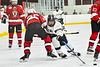 Syracuse Cougars Kiernan Proud (21) skates after the puck against Baldwinsville Bees Brayden Penafeather-Stevenson (25) in NYSPHSAA Section III Boys Ice hockey action at Meachem Ice Rink in Syracuse, New York on Thursday, February 13, 2020. Syracuse won 4-0.