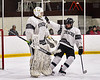 Syracuse Cougars goalie Alex Monero (1) gets congratulated for his shutout against the Baldwinsville Bees in NYSPHSAA Section III Boys Ice hockey action at Meachem Ice Rink in Syracuse, New York on Thursday, February 13, 2020. Syracuse won 4-0.