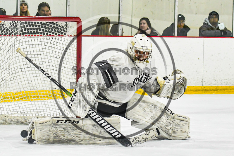 Syracuse Cougars goalie Alex Monero (1) makes a save against the Baldwinsville Bees on his way to a shutout in a NYSPHSAA Section III Boys Ice hockey game at Meachem Ice Rink in Syracuse, New York on Thursday, February 13, 2020. Syracuse won 4-0.