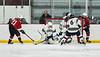 Syracuse Cougars goalie Alex Monero (1) makes a save against Baldwinsville Bees Brett Collier (21) in NYSPHSAA Section III Boys Ice hockey action at Meachem Ice Rink in Syracuse, New York on Thursday, February 13, 2020. Syracuse won 4-0.