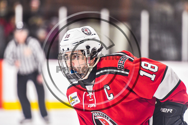 Baldwinsville Bees Matt Speelman (18) before a face-off against the Syracuse Cougars in NYSPHSAA Section III Boys Ice hockey action at Meachem Ice Rink in Syracuse, New York on Thursday, February 13, 2020. Syracuse won 4-0.