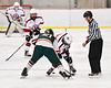 Baldwinsville Bees Tyler Derito (27) facing off against Fulton Red Raiders Freddy White (21) in NYSPHSAA Section III Boys Ice Hockey action at the Lysander Ice Arena in Baldwinsville, New York on Thursday, February 20, 2020. Baldwinsville won 2-1.