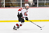 Baldwinsville Bees Casey Scott (20) with the puck against the Fulton Red Raiders in NYSPHSAA Section III Boys Ice Hockey action at the Lysander Ice Arena in Baldwinsville, New York on Thursday, February 20, 2020. Baldwinsville won 2-1.
