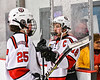 Baldwinsville Bees Matt Speelman (18) greets his teammates coming off the ice after defeating the Fulton Red Raiders in a NYSPHSAA Section III Boys Ice Hockey playoff game at the Lysander Ice Arena in Baldwinsville, New York on Thursday, February 20, 2020. Baldwinsville won 2-1.