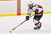Baldwinsville Bees Brett Collier (21) skating with the puck against the Fulton Red Raiders in NYSPHSAA Section III Boys Ice Hockey action at the Lysander Ice Arena in Baldwinsville, New York on Thursday, February 20, 2020. Baldwinsville won 2-1.