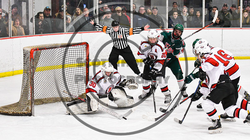 Referee indicates no goal as Baldwinsville Bees players converge to keep the puck from the Fulton Red Raiders in NYSPHSAA Section III Boys Ice Hockey action at the Lysander Ice Arena in Baldwinsville, New York on Thursday, February 20, 2020. Baldwinsville won 2-1.