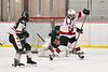 Fulton Red Raiders goalie Jadon Lee (1) makes a save against Baldwinsville Bees Brett Collier (21) in NYSPHSAA Section III Boys Ice Hockey action at the Lysander Ice Arena in Baldwinsville, New York on Thursday, February 20, 2020. Baldwinsville won 2-1.