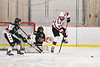 Baldwinsville Bees Braden Lynch (23) jumps out of the way of the puck shot at Fulton Red Raiders goalie Jadon Lee (1) in NYSPHSAA Section III Boys Ice Hockey action at the Lysander Ice Arena in Baldwinsville, New York on Thursday, February 20, 2020. Baldwinsville won 2-1.