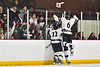 Syracuse Cougars players and students celebrate the winning goal against the Baldwinsville Bees in NYSPHSAA Section III Boys Ice hockey playoff action at Meachem Ice Rink in Syracuse, New York on Wednesday, February 26, 2020. Syracuse won 3-2.