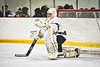 Syracuse Cougars goalie Alex Monero (1) during a timeout against the Baldwinsville Bees in NYSPHSAA Section III Boys Ice hockey playoff action at Meachem Ice Rink in Syracuse, New York on Wednesday, February 26, 2020. Syracuse won 3-2.