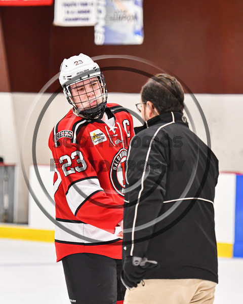 Baldwinsville Bees Braden Lynch (23) shake hands with the Syracuse Cougars team after a NYSPHSAA Section III Boys Ice hockey playoff game at Meachem Ice Rink in Syracuse, New York on Wednesday, February 26, 2020. Syracuse won 3-2.