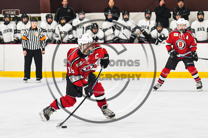 Baldwinsville Bees Matt Speelman (18) leans into a shot at the Syracuse Cougars net in NYSPHSAA Section III Boys Ice hockey playoff action at Meachem Ice Rink in Syracuse, New York on Wednesday, February 26, 2020. Syracuse won 3-2.