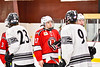 Baldwinsville Bees Christian Ficarra (17) shake hands with the Syracuse Cougars team after a NYSPHSAA Section III Boys Ice hockey playoff game at Meachem Ice Rink in Syracuse, New York on Wednesday, February 26, 2020. Syracuse won 3-2.