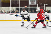 Baldwinsville Bees Ryan Dickinson (6) with the puck against Syracuse Cougars Kiernan Proud (21) in NYSPHSAA Section III Boys Ice hockey playoff action at Meachem Ice Rink in Syracuse, New York on Wednesday, February 26, 2020. Syracuse won 3-2.
