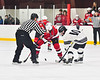 Baldwinsville Bees Alexander Pompo (5) faces off against Syracuse Cougars Ryan Durand (10) in NYSPHSAA Section III Boys Ice hockey playoff action at Meachem Ice Rink in Syracuse, New York on Wednesday, February 26, 2020. Syracuse won 3-2.