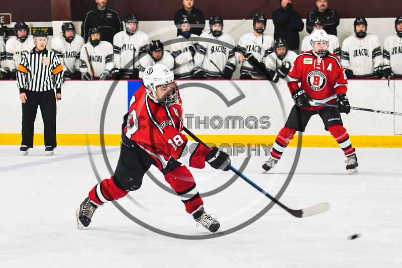 Baldwinsville Bees Matt Speelman (18) fires the puck at the Syracuse Cougars net as time wind down in NYSPHSAA Section III Boys Ice hockey playoff action at Meachem Ice Rink in Syracuse, New York on Wednesday, February 26, 2020. Syracuse won 3-2.