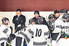 Syracuse Cougars Head Coach talks with his team during a time out against the Baldwinsville Bees in NYSPHSAA Section III Boys Ice hockey playoff action at Meachem Ice Rink in Syracuse, New York on Wednesday, February 26, 2020. Syracuse won 3-2.