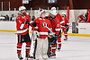 Baldwinsville Bees players Alexander Pompo (5), goalie Brad O'Neil (30) and Brett Collier (21) wait to congratulate the Syracuse Cougars for their win in a NYSPHSAA Section III Boys Ice hockey playoff game at Meachem Ice Rink in Syracuse, New York on Wednesday, February 26, 2020. Syracuse won 3-2.