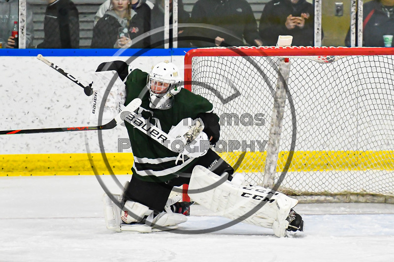 Fayetteville-Manlius goalie Hornets Konrad Walberger (1) makes a blocker save against the West Genesee Wildcats in a NYSPHSAA Section III Boys Ice hockey playoff game at the Shove Park in Camillus, New York on Wednesday, February 26, 2020. West Genesee won 4-1.