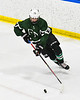 Fayetteville-Manlius Hornets Spencer Sasenbury (28) with the puck against the West Genesee Wildcats in a NYSPHSAA Section III Boys Ice hockey playoff game at the Shove Park in Camillus, New York on Wednesday, February 26, 2020. West Genesee won 4-1.