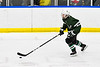 Fayetteville-Manlius Hornets Spencer Sasenbury (28) skating with the puck against the West Genesee Wildcats in a NYSPHSAA Section III Boys Ice hockey playoff game at the Shove Park in Camillus, New York on Wednesday, February 26, 2020. West Genesee won 4-1.